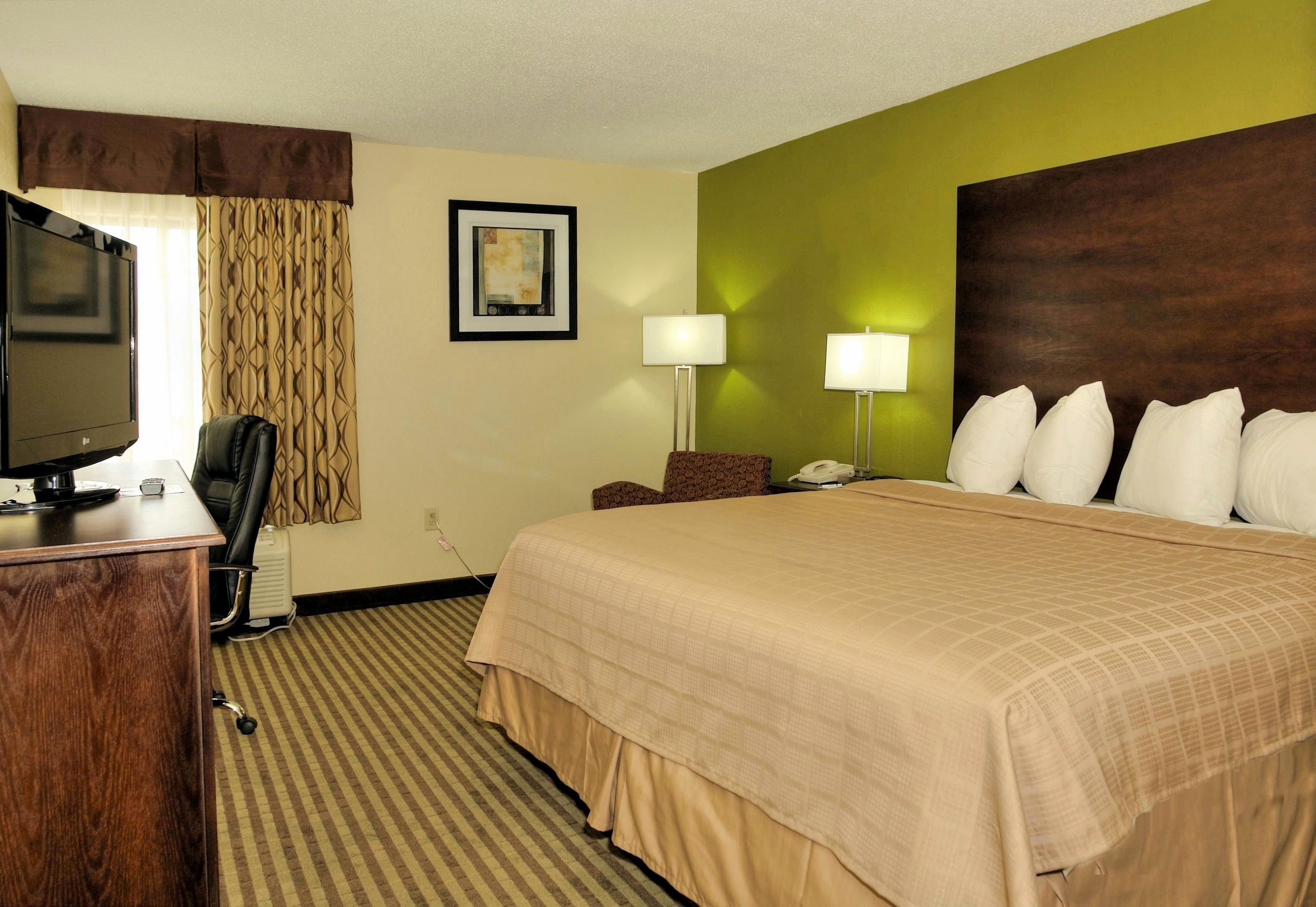 Comfortable King Size bed perfect for couples traveling to Jacksonville NC